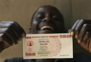 Vengai Chigaramumba laughs while holding the new ten million dollar note introduced by the Reserve Bank of Zimbabwe, Friday, Jan. 18, 2008.   The Reserve Bank governor Gideon Gono said the new note would provide relief to consumers who often go shopping with sacks of cash as Zimbabwe battles with the worlds highest inflation estimated at over 25,000 percent. (AP PHOTO/Tsvangirayi Mukwazhi)